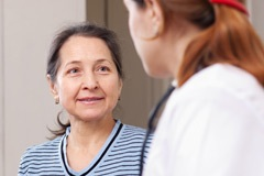 Woman in conversation with her doctor